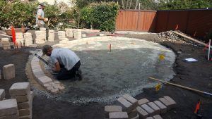 Laying blocks for a block wall in San Luis Obispo, CA